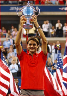 Roger Federer proudly poses with his trophy after winning the 2008 Men's US Open Final.